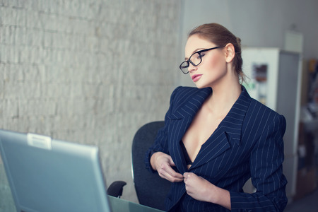 Sexy secretary in glasses undress in office, online flirt and desire