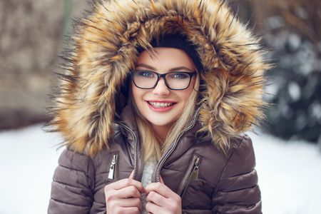 shiver: Blonde woman shiver outdoor at winter in glasses