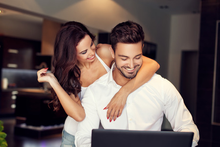 rich: Happy young couple online shopping, indoor lifestyle