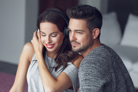 boyfriend: Young couple listening music at home, indoor