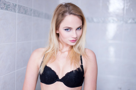 nude blonde girl: Sexy undressed blonde woman in bra at bathroom Stock Photo