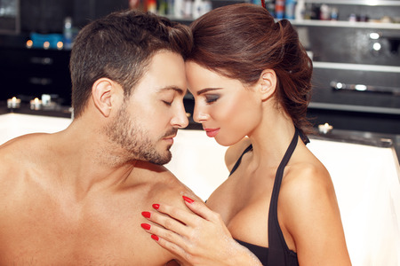 foreplay: Sensual couple in jacuzzi portrait, put heads together, honeymoon