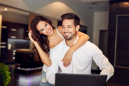 rich people: Successful young couple laughing indoor in flat