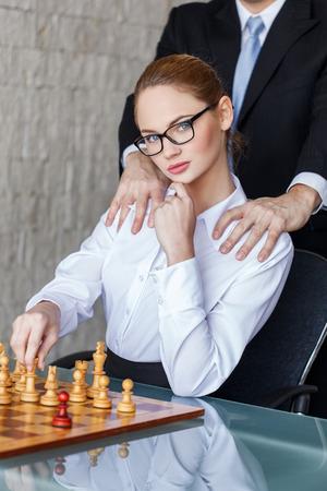 Boss grip secretary in office with chessboard, secret relationship, tactics Banco de Imagens