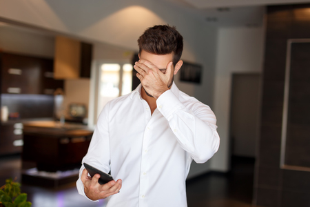 young guy: Businessman got bad news on tablet, business failure