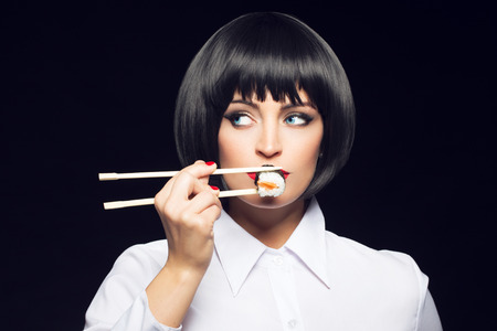 gluttonous: Gluttonous woman eating sush on black background, vintage style