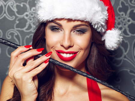 sex santa: Sexy santa woman with whip portrait, red lips, bdsm