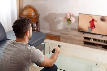 adult sex: Man watching sex movie in TV on adult channel