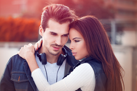 romantic couple: Young couple in love posing outdoor at autumn date