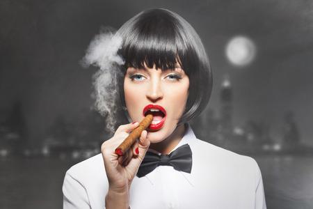 james: Sexy mafiosi woman boss smoke with cigar in town