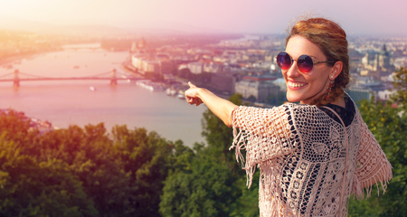 sightsee: Young woman showing Budapest panorama in sunset, Hungary Stock Photo