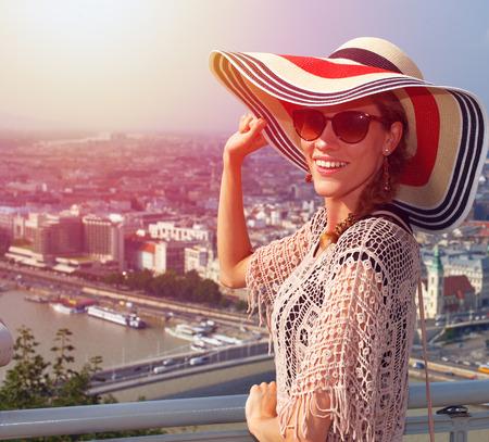 sightsee: Young woman enjoying Budapest panorama in sunset, Hungary