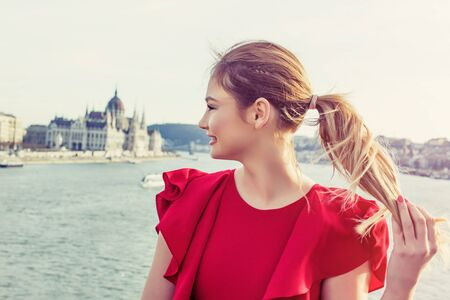 sightsee: Happy young woman in red dress enjoying Budapest panorama, Hungary