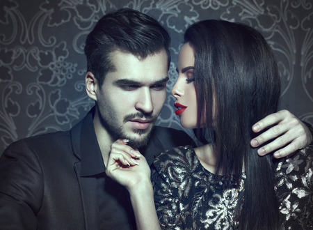 Romantic woman seducing young stylish rich man