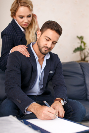 associate: Young businesswoman seducing rich businessman while signing contract