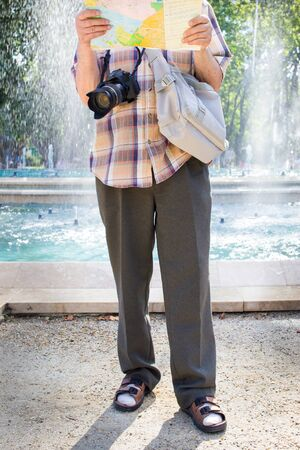 b378ece6faa Senior tourist man with camera and map socks and sandals Stock Photo