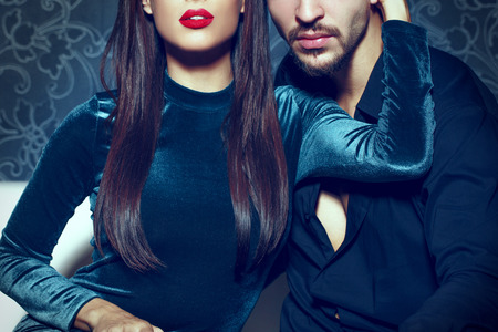 Sexy woman with red lips embrace young rich man, seduction Stock Photo - 82493520