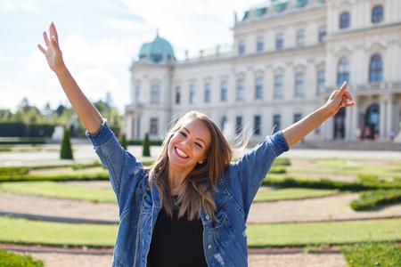 Happy young woman enjoying city tour in Belvedere garden, Vienna, Austria Stock fotó