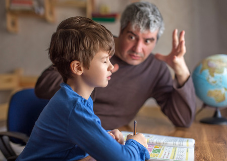 Father explainn mathematics with passion to little lazy son