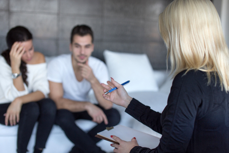 Blonde therapist discussing with couple on consulation, couple therapy