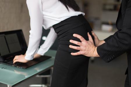 Boss grab secretary ass in office closeup, sexual harassment Foto de archivo