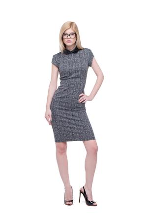 Jeune femme d'affaires intelligente en robe grise posant isolé sur blanc Banque d'images - 97785372