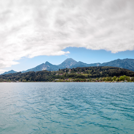 Turquoise water of Faaker See with Alps Austria, EU Stock Photo