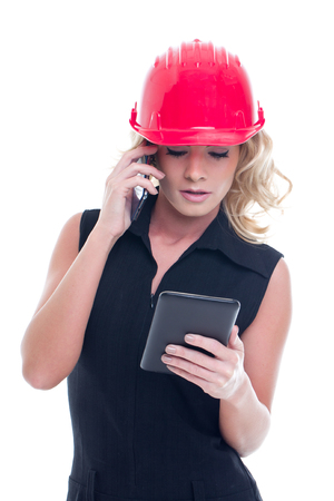 Young construction manager calling and using tablet isolated on white background