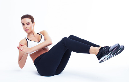 Young fit woman doing russian twist, abs exercise Stock Photo