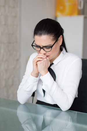 Young businesswoman crying about her situation in job Stock Photo