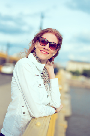 Stylish young woman with new life portrait on bridge, vintage style