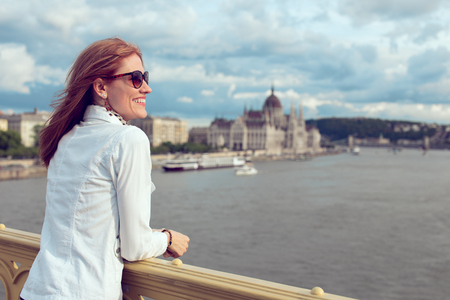 Happy young brunette woman sightseeing at Budapest, smile, enjoying panorama