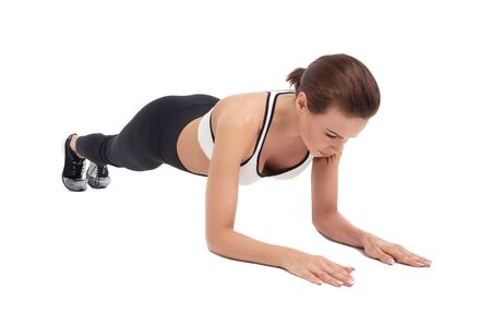 Young woman doing plank exercise, isolated on white background