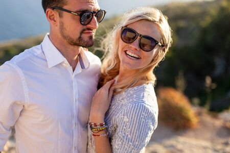 Young stylish couple in nature at summer portrait
