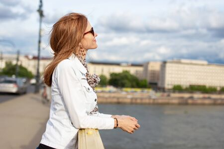 Young redhead woman enjoying sunny autumn day at Budapest, Hungary