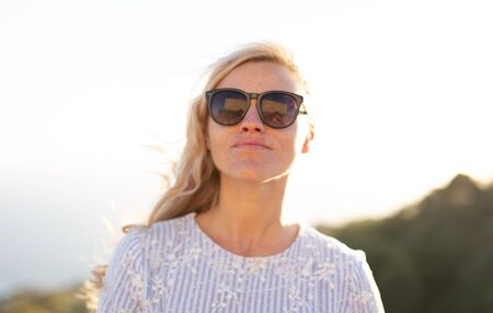 Young blonde natural caucasian woman in sunglasses portrait outdoors in nature Stock fotó