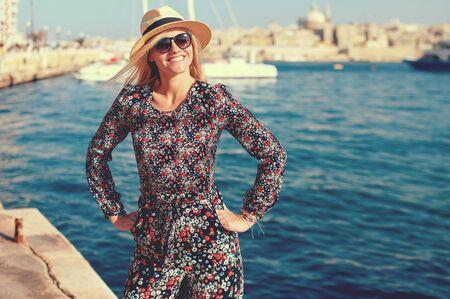 Young traveler woman posing at Mediterranean sea, Malta, Sliema, vintage style Stock fotó