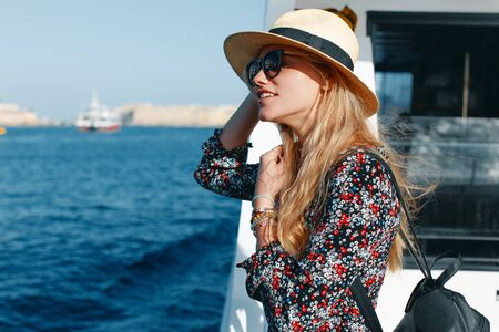 Happy blonde Mediterranean woman amazed by panorama on cruise ship Stock fotó