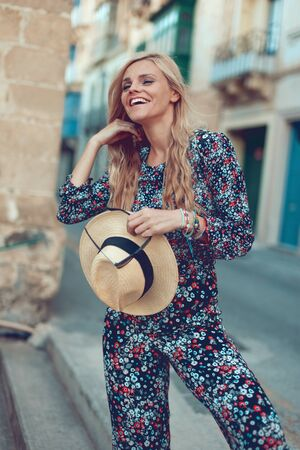 Happy young fashionable blonde woman posing at Mediterranean street, happiness Stock fotó