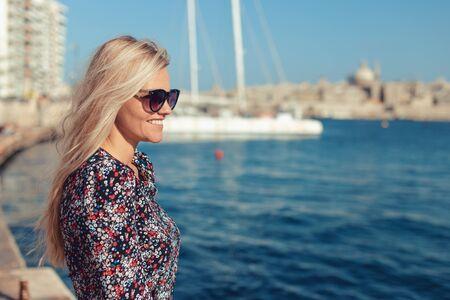 Young blonde Mediterranean woman smiling at Valletta, Malta
