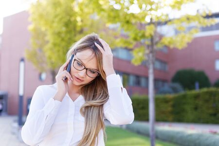 Young businesswoman forget appointment while calling in park