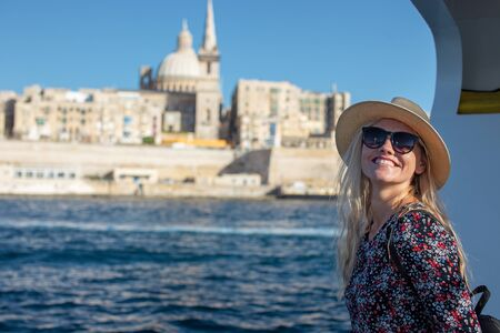 Happy young 20s traveler woman arriving to Valletta, Malta