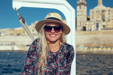 Happy young 20s traveler woman traveling by ship on Mediterranean sea