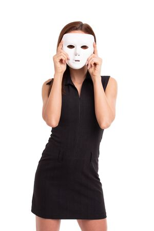 Young woman holding white mask in front of face, isolated on white