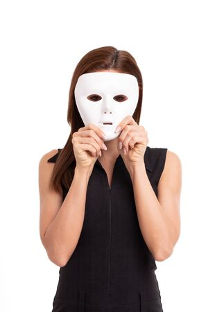Young woman holding white mask in front of face portrait, isolated on white 스톡 콘텐츠