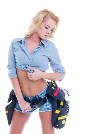 Sensual blonde woman in denim short with tool holster, isolated on white Standard-Bild
