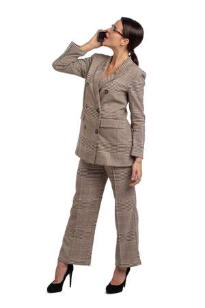 Professional young businesswoman in gray formal wear calling and looking up, isolated on white