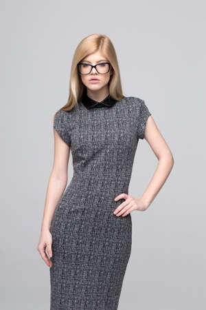 Blonde young smart Caucasian businesswoman posing