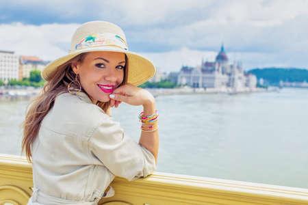 Happy young tourist woman posing at Margaret bridge, visit Budapest, Hungary