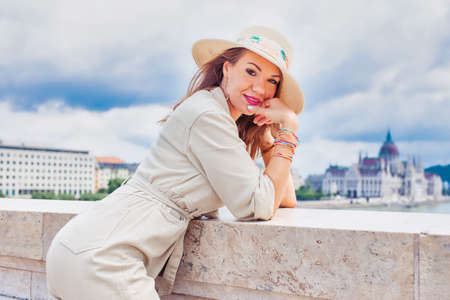 Young woman in hat posing at outdoors, Budapest, Hungary